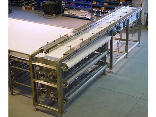 Multi tier cooling conveyor with reciprocator 500x375
